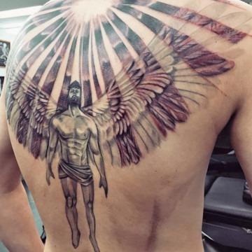 Angel tattoo by Primitive tattoo artists